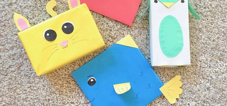 Cadeau's creatief ingepakt als een kat, vis en pinguin